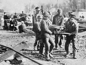 West Virginia coal miners carry the body of a co-worker killed on the job in 1907