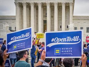 Supporters of LGBTQ rights rally outside the U.S. Supreme Court as the Masterpiece Cakeshop decision is announced