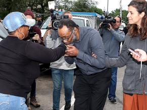 Jackie Wilson (center) greets supporters after his release from prison in Chicago