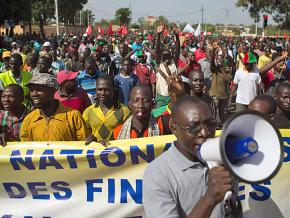 Workers take part in mass demonstrations in Burkina Faso during the 2014 Burkinabé uprising