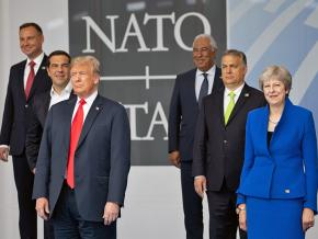 Donald Trump poses with other heads of state at the 2018 NATO summit