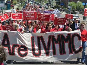 UVM nurses and their supporters march through the streets of Burlington