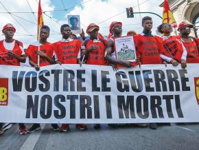 Migrant workers march in Rome against racist violence