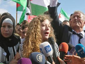 Ahed Tamimi (center) addresses supporters and the press after her release