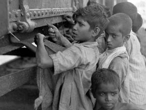Children attempt to open a grain car in the famine in Bengal during 1943