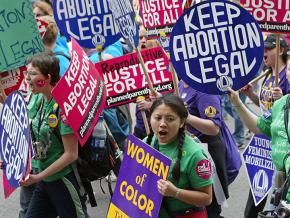Activists march in defense of women's reproductive rights
