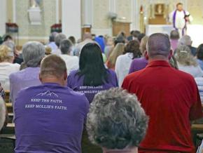 Mourners attend a church service for Mollie Tibbetts in Brooklyn, Iowa