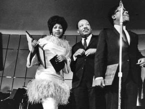 Aretha Franklin (left) and Martin Luther King Jr. on stage together in Detroit in 1968