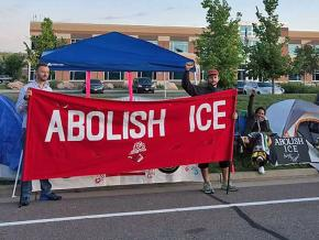 Activists protest outside an ICE field office in Centennial, Colorado
