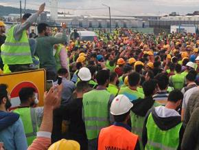 Construction workers protest conditions at a site for a new airport in Istanbul