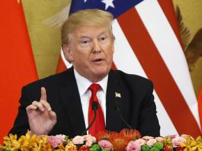 Donald Trump speaks to the press during a visit to China