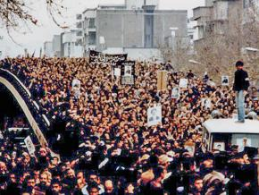 Thousands take part in a mass demonstration during the Iranian revolution