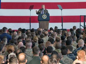 Donald Trump delivers an address at the Yokota Air Base in Japan