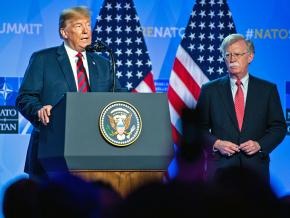 Donald Trump addresses the 2018 NATO summit alongside National Security Advisor John Bolton