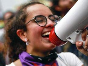 Juliana Vargas leads chants for marching students
