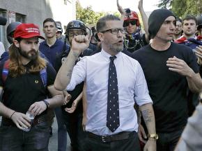 Proud Boys founder Gavin McInnes (center) leads a march of the far right
