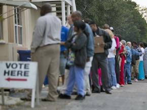 Voters wait in line to cast their ballots in Florida