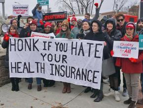 Single-payer activists rally outside a health insurance industry conference
