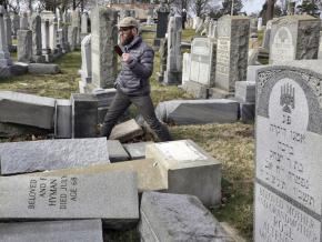 Surveying the damage to the Mount Carmel Cemetery in Philadelphia following racist vandalism