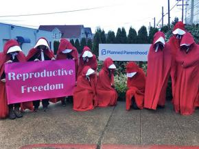 "A ""Handmaid's vigil"" challenges the anti-choicers in Everett, Washington"