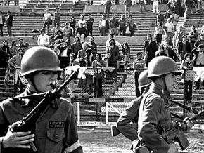 Soldiers watch over leftists and labor organizers in Chile's National Stadium in 1973