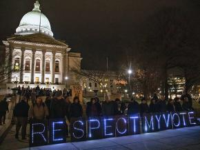 Rallying outside the Wisconsin state Capitol against Republican power grabs