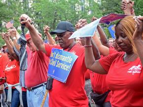 AFGE members go #RedForFeds in Washington, D.C., to protest Trump's union-busting.