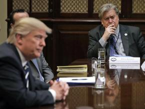 Donald Trump presides over a White House event as Steve Bannon (right) looks on