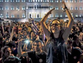 "People flood into the square outside Greece's parliament to celebrate the ""no"" victory"