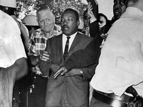 Martin Luther King marches into Chicago's Marquette Park, shortly before he was struck by debris thrown by counterdemonstrators