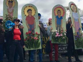 Protesters march in solidarity with the refugee caravan in San Diego