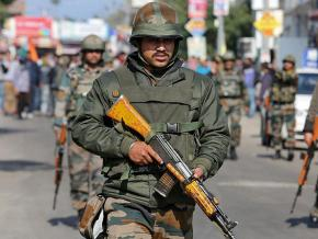 Indian troops enforce a curfew in occupied Kashmir