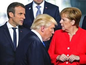 Left to right: French President Emmanuel Macron, Donald Trump and German Chancellor Angela Merkel
