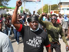 Protesters take part in anti-government demonstrations in Port-au-Prince